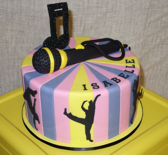 Disco birthday cake with hand cut dancing silhouettes and hand crafted edible microphone.  Visit my Facebook page Driving Me Cakey or contact me via e-mail drivingmecakey@gmail.com. Located in South Australia.