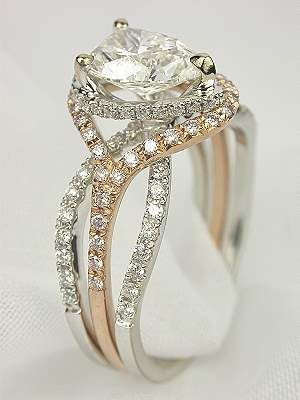 Pear Shaped Diamond Engagement Ring in White Gold with Rose Gold Trim.: