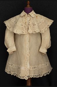 Child's linen coat set, c.1905. Closes in front with 3 fancy mother-of-pearl buttons. Fine finishing.