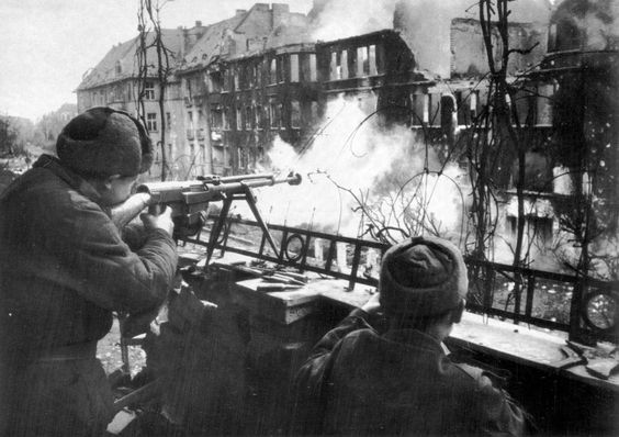 Breslau, 1945: Red Army troops fire the semi-automatic Simonov 41 anti-tank/anti-material rifle at targets across the street. The 41 was used heavily on the Eastern Front and saw action post-war in Korea and other parts of the world. The 41 had devastating terminal ballistics and was an authoritative presence in the hands of trained personnel.