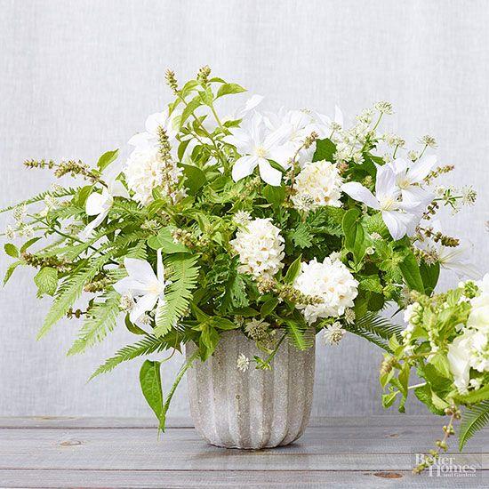 Cement planters centerpieces and flower arrangements on