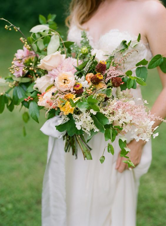 organic peach toned bouquet, photo by Faith Teasley http://ruffledblog.com/bloomsbury-farm-wedding-inspiration #weddingbouquet #flowers