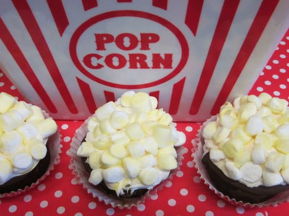 Wanna pop a smile.....I will be making these for the boys birthday, but I use my own homemade cupcakes as the base....also fun for movie night.