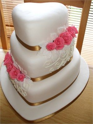 3 Tier Heart Shaped Wedding Cake Decorated with Ivory Piping and pink sugar roses