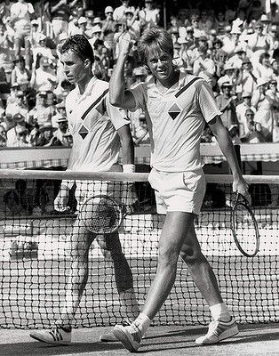 Nineteen-year-old Stefan Edberg waves to the crowd as he walks from centre court at Kooyong with a defeated and numb top seed Ivan Lendl in 1985.  Australian Open Tennis :)