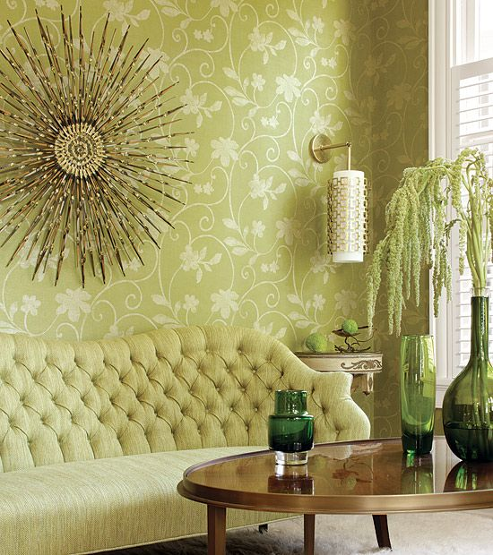 Go Green all the way!  #Thibaut's Kohala textured vinyl Wallcovering in Lime Green from Texture Resource Volume 3    #vines #sunburstmirror #tuftedsofa #70s #chic #green #floral #leaves #gold #sconce