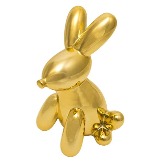 Crafted from high-gloss electroplated ceramic, this cutesy rabbit money bank features a plug on its bottom for retrieving your coins.