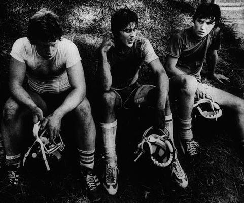 Photo Title The Camp of Dust and Blisters Photographer/Creator Fred Barnes Collection 1981 Publisher Grand Rapids Press Caption/Description After practicing 3 times a day in the heat, players take a break.
