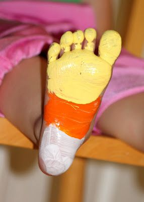 Candy Corn Foot Print...stamp onto paper and write TRICK OR TREAT SMELL MY FEET