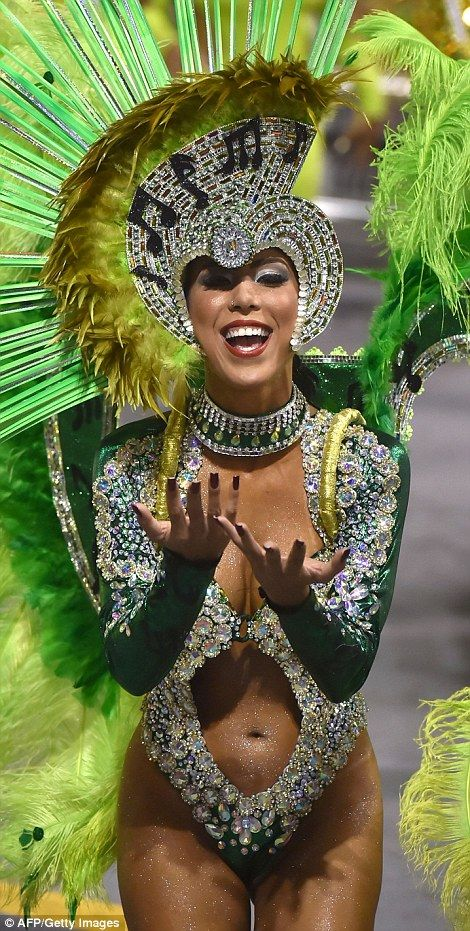 Uncovered: Two female dancers take to the streets of Sao Paulo during the Carnival celebrations despite warnings that the traditional clothes - or lack thereof - worn by performers and revellers could expose them to mosquitoes