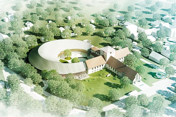 the competition-winning design employs a bold circular structure that integrates with the site's existing architecture.