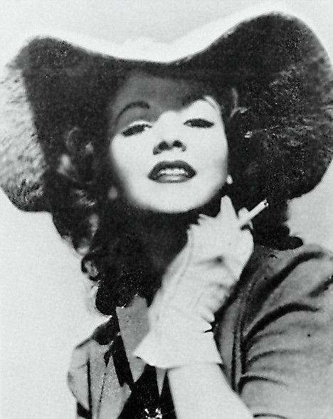 Barbara Baekeland  disgusting woman who seduced her own son to 'cure' him of his gayness.   Just love the picture, the hat and shadows