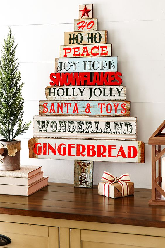 Evergreens tend to get the most attention this time of year, but Pier 1's wooden Sentiments Tree is equally holly and jolly. The hand-painted holiday messages on rustic pine bring Christmas cheer to any wall in your home.: