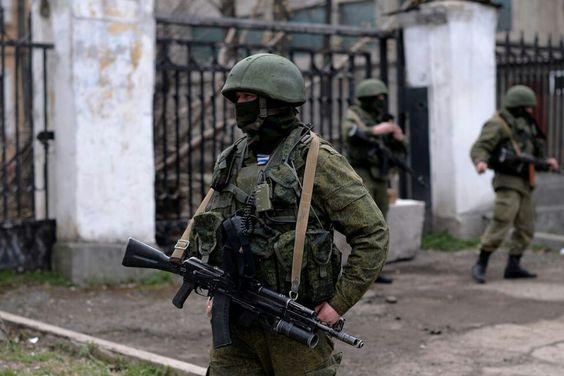 Russians outside Ukrainian military base in Crimea