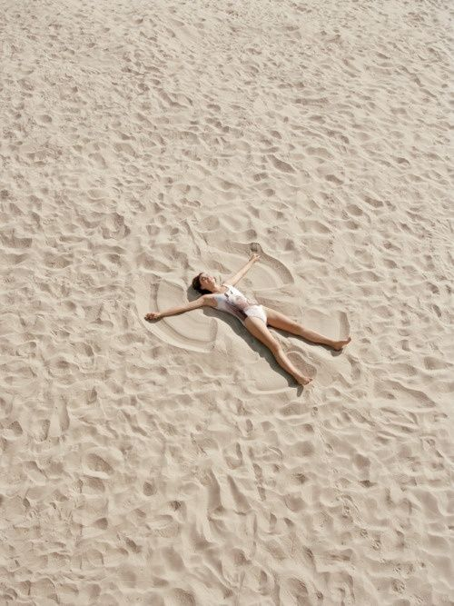 Make sand angels on the beach.