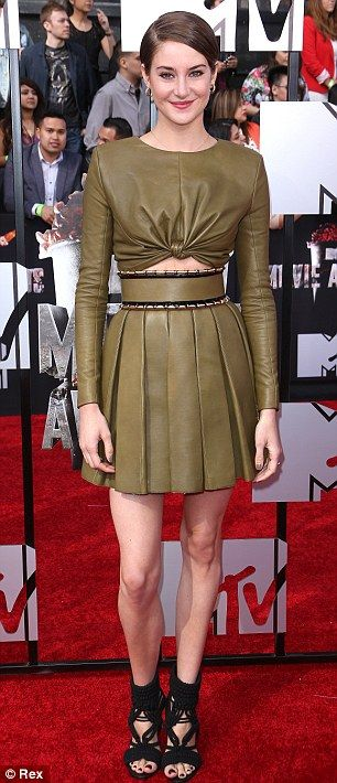 Sexy and smart: The actress showed some skin in the slightly cropped top and…