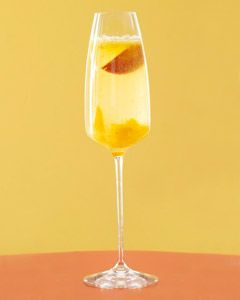 Bellini     1 peach wedge  ½ ripe peach, peeled and pitted  ½ oz peach liqueur Champagne    Preparation    Place the peach wedge in a champagne flute. Process the peach in a blender and pour the puree into the glass. Add the peach liqueur, top with some chilled champagne, and stir gently.