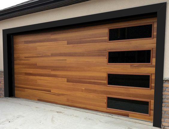 Accent planks on this C.H.I. cedar door make it a strong statement piece, but the timeless beauty of the wood reins it back in.