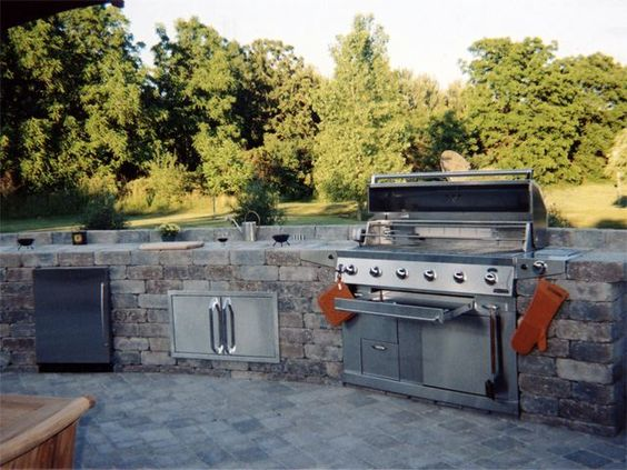 IN THE YARD:  Outdoor kitchen with built in grill, fridge, storage....all you need for a night of entertaining.