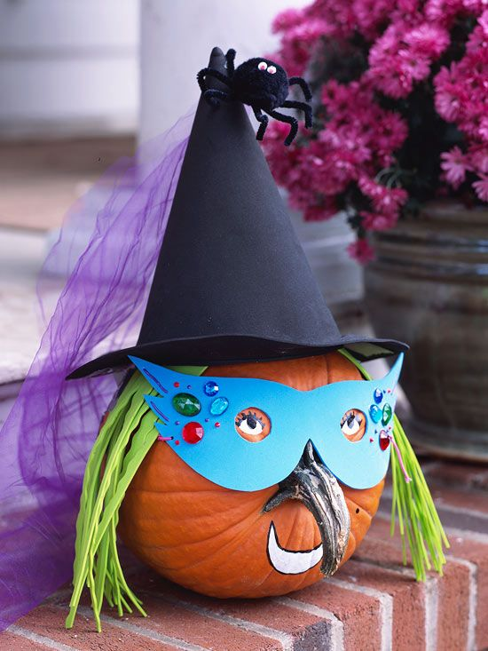 A pumpkins stem makes a cute nose for this adorable witch pumpkin. More easy Halloween crafts: www.bhg.com/...