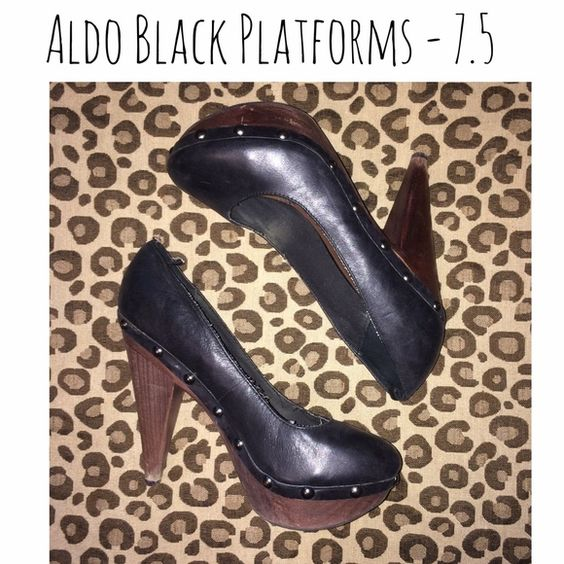 ALDO BLACK WOODEN PLATFORMS ALDO black wooden platforms with accent studs. These have been worn and do show some wear but are still great shoes! ALDO Shoes Platforms