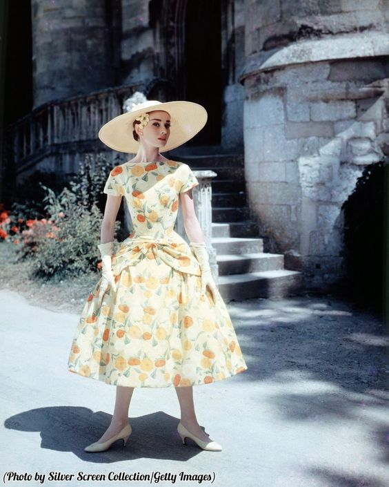 """ClassicPics on Twitter: """"Audrey Hepburn in a floral-print day dress and sun hat, circa 1955. https://t.co/w7oy9V2FPZ"""""""