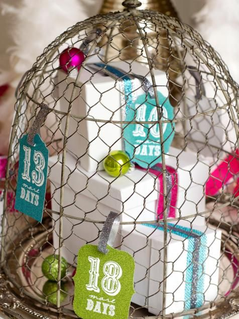 Make family meals even more fun by adding a unique advent calendar centerpiece to the table. Jessica Wilcox uses a vintage chicken-wire cloche dome as the base for her decorative advent calendar. To make your own, add presents, colorful ornaments and ribbons underneath the dome. On the outside, attach the Christmas countdown tags to represent the number of presents inside. Each day, remove a tag and open a present until Christmas arrives. Check out our 50  (free!) printable templates.