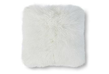 Snuggly soft and rich with naturally waved and curled texture, this Mongolian lamb-fur cushion is an inviting, chic accent.