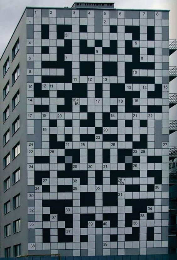 Ook Oekraïne: Crossword puzzle building, Lviv, Ukraine. Sign architectural wrap building foil vinyl