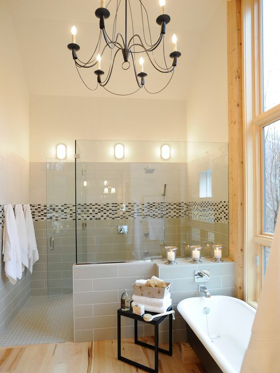 Lighting a shower area can be tricky — one rule to follow: only use fixtures that are rated for use in damp or wet locations. The three nautical clam-shell style lights along the back wall of this HGTV Dream Home shower are a good example. The bulbs and all electrical components are totally enclosed so moisture isn't an issue.
