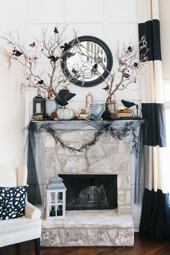 21 Halloween Mantel Decorating Ideas That Will Spruce Up Your Fireplace Setting Halloween Living Room Classy Halloween Decor Elegant Halloween Decor