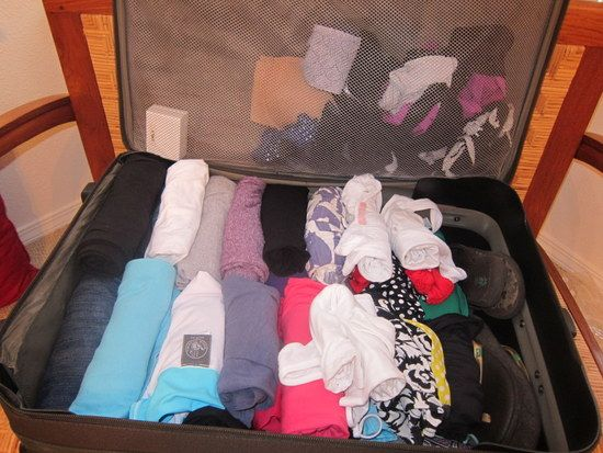 I ALWAYS check a bag. Good visual on how to fit the most into a rolling suitcase to be checked!