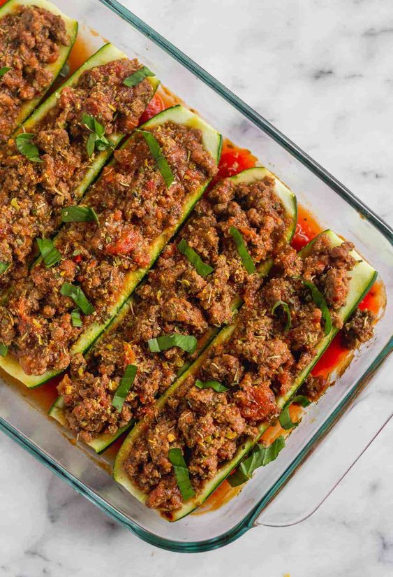 Only 5 ingredients for these easy and flavorful Whole30 Italian Beef Zucchini Boats! They make a simple gluten free, paleo, and low carb meal perfect for an effortless weeknight dinner or meal prep! - Eat the Gains #whole30 #paleo #mealprep #5ingredients
