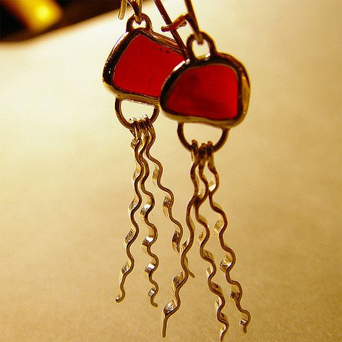 https://flic.kr/p/5QixPW | Jelly Fish Red Sea Glass Earrings | I made these for my wifes birthday which is today.  I made two pair so that will give her a choice :)  These are  jelly fish earrings I made my usual No-back sterling silver band bezel.  I formed the earring wires then hammered the union to strengthen them.  --www.theglasscrafter.com