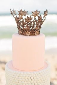 Simple white and pink princess cake with golden crown topper
