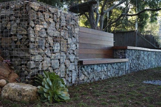Gabion basket walls and Ipe bench. Great solution.