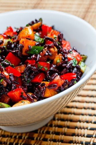 Thai Black Rice Salad (forbidden black rice, 1 red pepper, 1 mango, 3 green onions, cilantro, mint, 1/2 cup cashews, 2 tbsp soy sauce, 1 lime (juice and zest), palm sugar, and 1 birds eye chili)