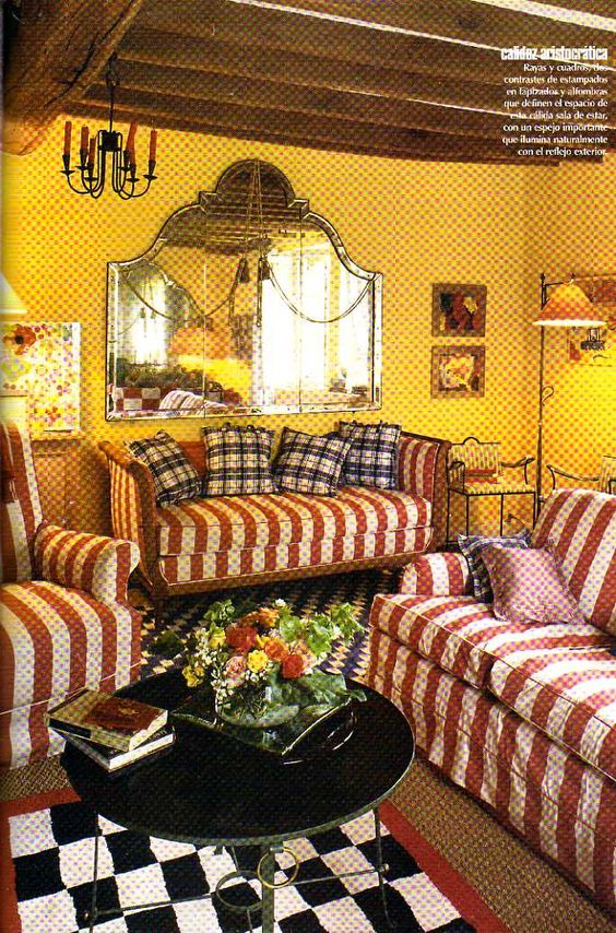 Ines' Normandy cottage interior. Love the red stripes and yellow walls. She is an arbiter of style!