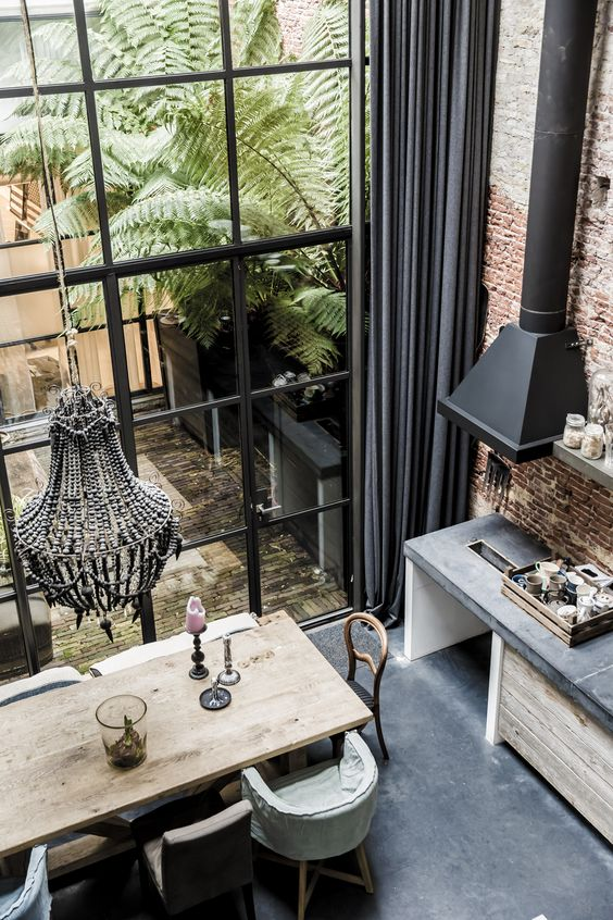 huge black critall windows, chandelier, exposed brick and a general air of urban glamour