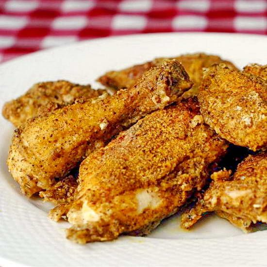 Oven Fried Chicken - coated in a terrific blend of herbs and spices with all the flavour of crispy, moist, juicy fried chicken without frying or a lot of added fat.