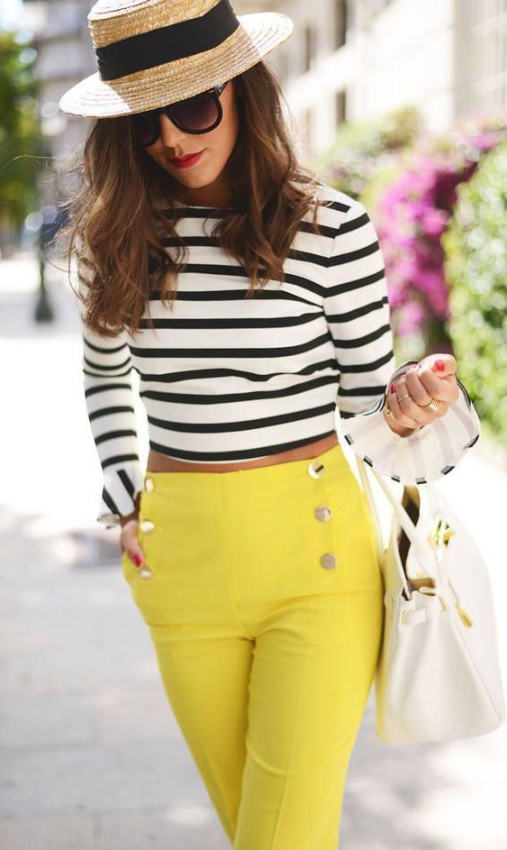 Streetstyle. Striped crop top with yellow high wasted pants.