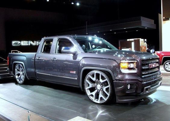 Quad cab GMC Sierra with big wheels and lowered suspension. A practical truck to move materials, tools and people at the same time. I'll take this over a sedan any day of the week...