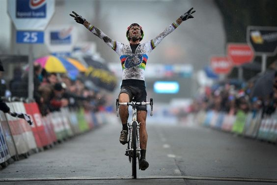 Belgian Niels Albert celebrates as he crosses the finish line to win the Azencross (Cross des As), the fifth stage in the Bpost Bank Trofee Cyclocross competition, on December 28 in Loenhout.