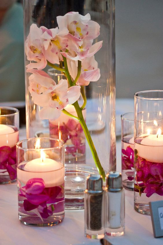 Maui wedding orchid centerpieces with floating candles by for Creative things to put in vases