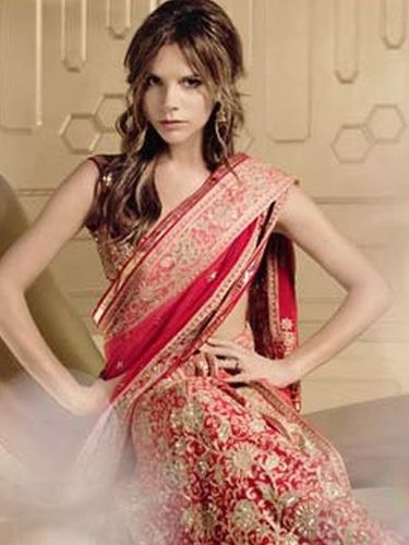 Victoria Beckham wearing Tarun Tahiliani saree for Vogue