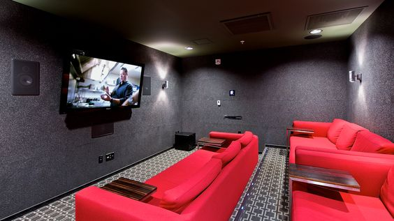 Makes you feel like you're in a normal movie theater, not a custom home movie theater. The red velvet silk sofas, dar purple walls, and dim lighting make it a perfect setting to grab a blanket and pillow, snuggle up, eat some popcorn and watch some movies all night in this custom home movie theater.