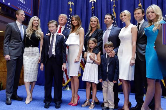 Meet the Trump clan: America's next dynasty?......Donald Trump poses with his family - AP Photo/Richard Drew
