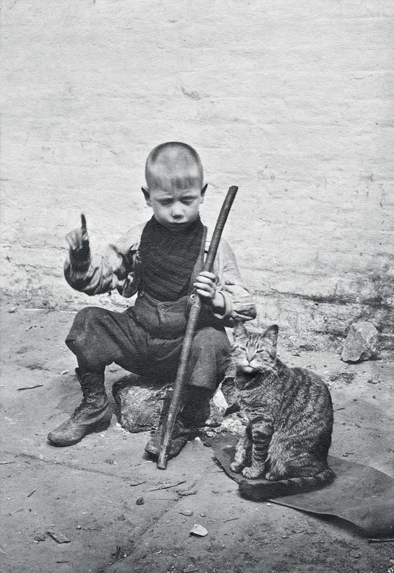 Puss 'n' boots: Jeremiah Donovan, six, was nicknamed Dick Whittington because of his pet cat. But the newspaper vendor's son did not find London's streets paved with gold