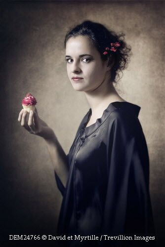 Trevillion Images - woman-holding-cupcake