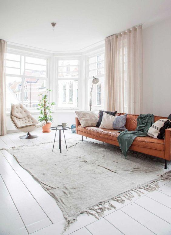 Tan sofa in a light Dutch home in a former cheese warehouse